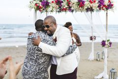 African American couple getting married at the beach stock image