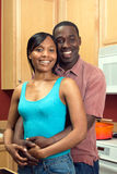 African American Couple In Kitchen - Vertical Royalty Free Stock Images