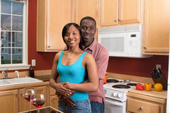 African American Couple in Kitchen-Horizont Stock Image