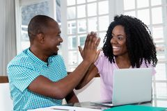 African american couple at laptop give high five Stock Photos