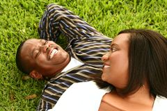 African American Couple Laying Stock Photo