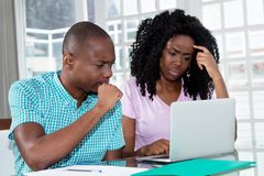African american couple looking online for jobs royalty free stock photo