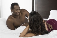 African American Couple Lying In Bed Stock Photography