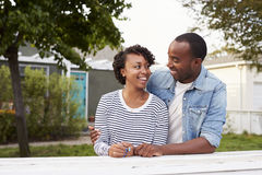 African American couple outside their new house stock images