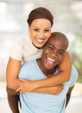 African american couple piggyback Stock Image