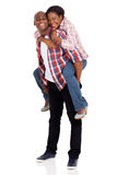 African american couple piggyback Stock Images