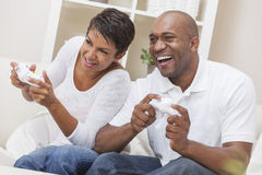 African American Couple Playing Video Console Game. African American couple, men and woman, having fun playing video console games together Stock Photography