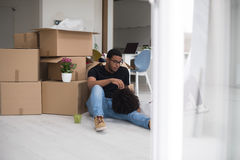 African American couple relaxing in new house Stock Photo