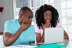 African american couple shocked about computer virus and identit stock images