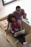 African american couple shopping online Stock Photo