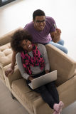 African american couple shopping online Stock Images