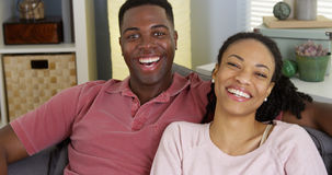 African American couple smiling at camera Stock Images