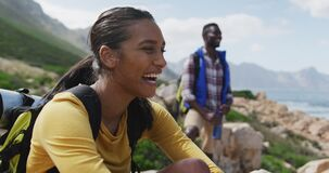 African american couple smiling and enjoying the view while hiking