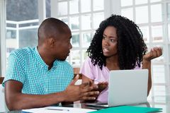 African american couple talking about social media fake news royalty free stock photos