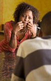 African-American couple talks in kitchen. Attractive couple in kitchen. Woman is concerned Stock Photos