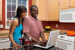African American Couple Using Laptop in Kitchen Royalty Free Stock Photography