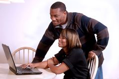 African-American couple viewing the computer. African-American couple enjoying the internet together royalty free stock images