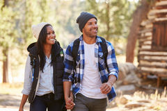 African American Couple Walking Through Fall Woodland stock photo