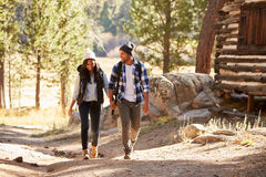 African American Couple Walking Through Fall Woodland royalty free stock photos