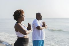 African American couple working out at the beach stock images