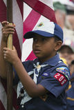 African American cubscout displays US Flag at solemn 2014 Memorial Day Event, Los Angeles National Cemetery, California, USA Stock Image