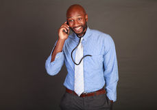 African American Doctor checks his phone Royalty Free Stock Images