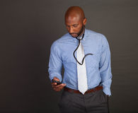 African American Doctor checks his phone Stock Photos