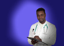 African american doctor with a clipboard Stock Images