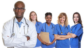 African american doctor with crossed arms and group of internati. Onal nurses on isolated white background Stock Image