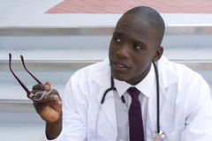 African American doctor gesturing outside Stock Image