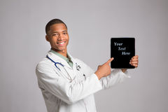 African American Doctor Holding a Notepad Royalty Free Stock Image