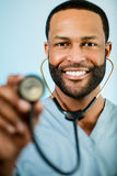 African American Doctor Holding Up A Stethoscope Royalty Free Stock Images
