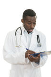 African American doctor shocked and scared by information on a clipboard. Royalty Free Stock Photography
