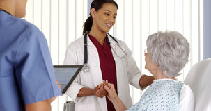 African American doctor talking to mature woman patient Royalty Free Stock Photo