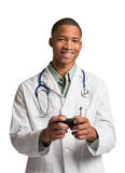 African American Doctor Texting on Smart Phone Royalty Free Stock Photos