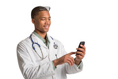 African American Doctor Texting on Smart Phone Royalty Free Stock Images