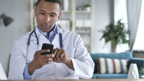 African-American Doctor Using Smartphone royalty free stock photo