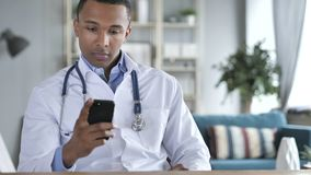 African-American Doctor Using Smartphone royalty free stock photos