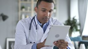 African-American Doctor Using Tablet for internet Browsing. 4k , high quality stock video