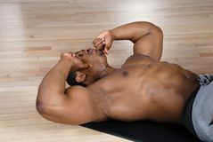 African american doing sit ups and crunches Stock Photos