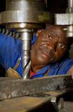 African American with drill press Royalty Free Stock Photos