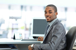 African American entrepreneur displaying computer laptop in office Royalty Free Stock Images