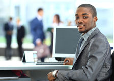 African American entrepreneur displaying computer laptop in office royalty free stock photo