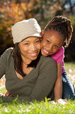 African American Family. Happy African American mother and child having fun spending time together in a park Royalty Free Stock Image