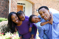 African American Family. Together outside their home Stock Photography