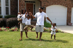African American Family. Together outside their home Stock Photos