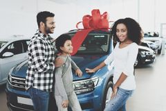 African american family at car dealership. Father, mother and son near new car, happy. African american family at car dealership. Father, mother and son near Royalty Free Stock Photo