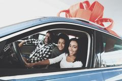 African american family at car dealership. Father, mother and son in new car. royalty free stock photo