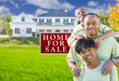 African American Family In Front of Sale Sign and House Royalty Free Stock Photos