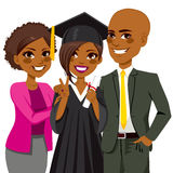 African American Family Graduation Day. African american family proud and happy of daughter holding diploma on graduation ceremony day Stock Photography